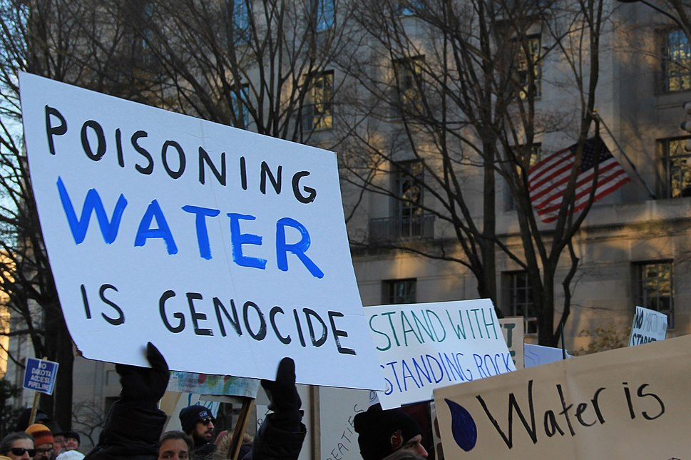 Poisoning water is genocide - Stand with Standing Rock