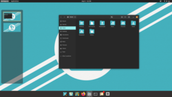 Pop! OS 21.04 with the COSMIC desktop.png