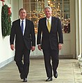 President Bill Clinton and President-Elect George W. Bush walk along the White House colonnade to the Oval Office (cropped).jpg