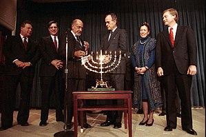 Dan Quayle - George H.W. Bush, Dan Quayle, and Marilyn Quayle participate in a Hanukkah Celebration.