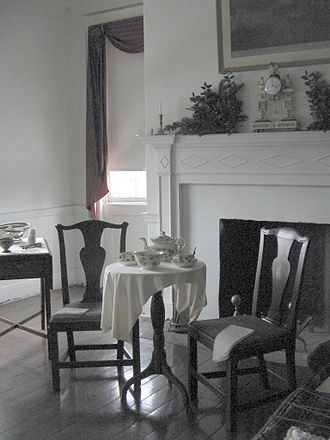 Joseph Priestley House - Bedroom in the Priestley home, with the couple's china tea set, mantel clock, and chairs