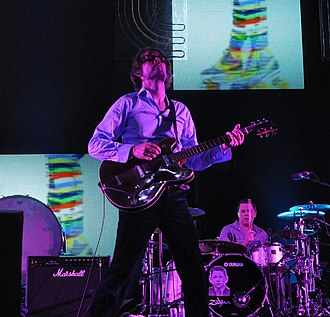 Pulp (band) - Jarvis Cocker performing with Pulp at the Coachella Festival in 2012.