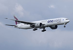 Qatar Airways - A Qatar Airways Boeing 777-300ER in Oneworld markings lands at Heathrow Airport in 2014.