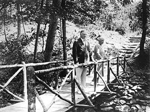 Rapidan Camp - Herbert and Lou Henry Hoover on a footbridge at camp