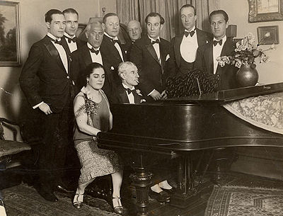 Ravel at the piano, accompanied by Canadian singer Éva Gauthier, during his American tour, March 7, 1928. At far right is George Gershwin.