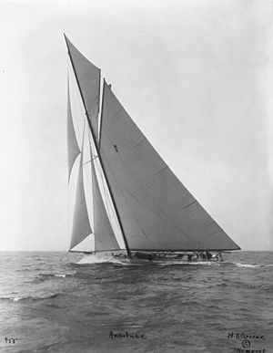 Black and white photograph of the yacht Resolute under full sail