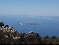 Robben Island as viewed from Table Mountain. T...