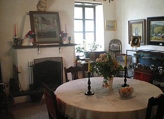 Rómulo Pico Adobe - Dining room at Rómulo Pico Adobe with original fireplace