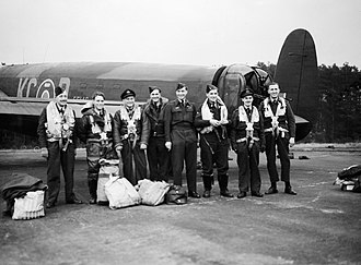RAF Woodhall Spa -  Wing Commander Tait, (fifth from left), standing with his crew by the tail of their Lancaster at Woodhall Spa, on returning from Lossiemouth, the day after the successful raid on the German battleship Tirpitz