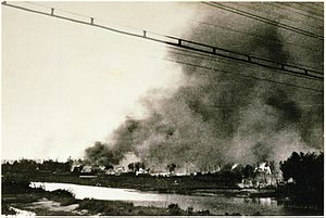 Słonim Ghetto - The burning Słonim Ghetto across the Szczara River during the Jewish revolt which erupted in the course of the final Ghetto extermination action, 29 June 1942