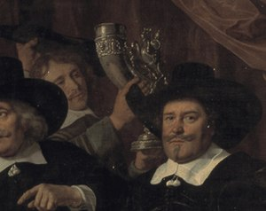 Banquet of the Amsterdam Civic Guard in Celebration of the Peace of Münster - Image: SA 7330 detail of the drinking horn De vier overlieden van het Sint Jorisgilde (cropped)