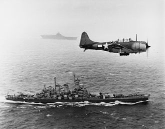 Pacific Ocean theater of World War II - An SBD Dauntless flies patrol over USS Washington and USS Lexington during the Gilbert and Marshall Islands campaign, November 12, 1943.