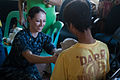 Sailor passes out toys at orphanage 130207-N-HN991-016.jpg