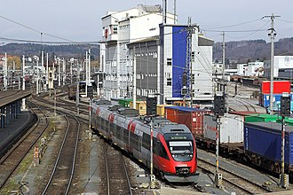 Salzburg Hauptbahnhof - S-Bahn train in front of the central signal box.