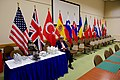 Secretary Kerry Sits Along an Array of Flags Between Meetings as he Attends a NATO Ministerial Meeting in Brussels (31483306745).jpg