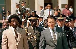 First Liberian Civil War - Samuel Doe with then Secretary of Defense of the United States Caspar W. Weinberger outside of the Pentagon in 1982.
