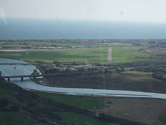 Shoreham Airshow disaster - Aerial view looking south-west towards Shoreham airport. The aircraft hit the A27 dual-carriageway between the River Adur, in the foreground, and the runway.
