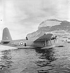 Short Sunderland Mark I, L5798 'KG-B', of No. 204 Squadron RAF moored beneath the North Face of the Rock of Gibraltar.jpg