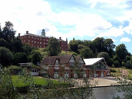 Shrewsbury School, with its boathouse on the River Severn in the foreground. Shrewsbury School and boathouse.JPG