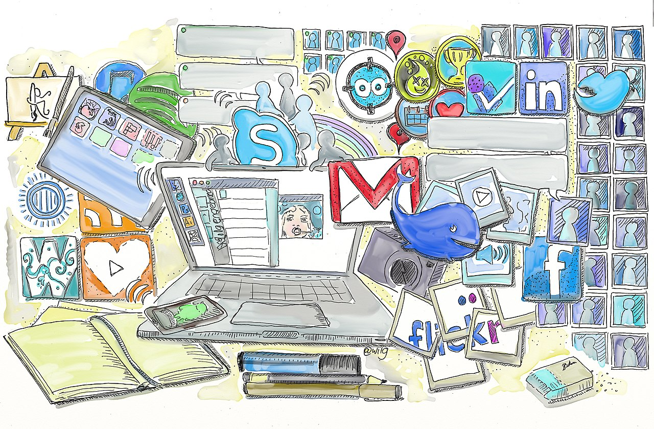 A picture of a laptop surrounded by social media icons