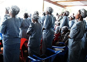 Basankusu - The Catholic religious order, the Theresienne Sisters of Basankusu at a mass for the taking and retaking of vows at the temporary structure built while the new cathedral was being built, 2013.