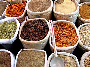 Indian cuisine - Spices at a grocery shop in India