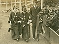 St. Louis Cardinals owner, Helene Britton (left) with her mother, Sarah Robison, and an unidentified man walking along the warning track in Sportsman's Park.jpg