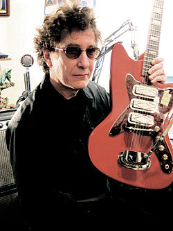 Stan Ridgway and a Harmony guitar.jpg