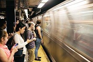 Rush hour - Morning rush hour on the New York City Subway platform at Jackson Heights–Roosevelt Avenue