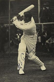 A cricketer batting