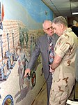 Stewart Wavell-Smith shows John Abizaid some of the images portrayed in the Enduring Freedom Mural.jpg