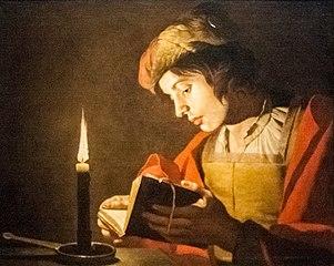 Jeune Homme lisant à la chandelle
