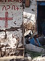 Street Scene with Woman and Painted Crucifix - Gondar - Ethiopia (8685102185).jpg