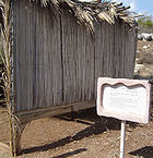 Sukkah with wall high from the ground.JPG