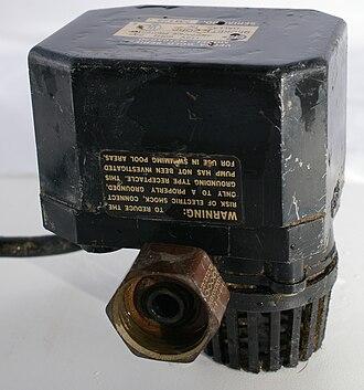 Sump pump - A small submersible AC sump pump with a garden hose connector