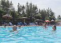 Swimming people in a pool Gambia.jpg