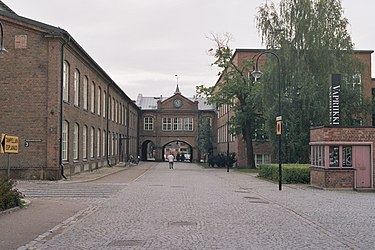 The former Tampella factory in Tampere, and factory's clock gate, which was built in 1891. Tampella clock gate in Tampere Aug2008.jpg