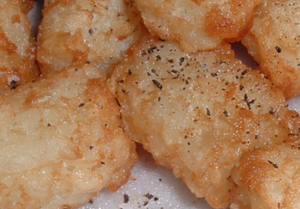 A close-up of a plate of Tater Tots.