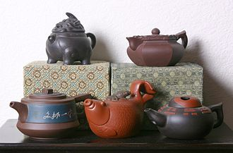 Tea culture - Five Yixing clay teapots showing a variety of styles from formal to whimsical