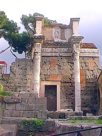 Nerva - The last remaining columns from the largely blind peristyle surrounding a temple to Minerva, located at the heart of the Forum of Nerva. The visible door frame is not an original element but rather one of the many modifications suffered during the Middle Ages.