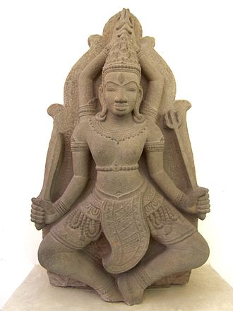 Art of Champa - This late 11th- or 12th-century sculpture illustrates both the preferred medium of the Cham artists (stone sculpture in high relief), and the most popular subject-matter, the god Shiva and themes associated with the god.  Shiva can be recognized by the third eye in the middle of his forehead and by the attribute of the trident.  The hands above his head are making the gesture called uttarabodhi mudra, which is regarded as a symbol of perfection.