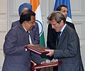 The Chairman ISROAntrix & Secretary Dept. of Space, Dr.G. Madhavan Nair and the Foreign Minister of France, Mr. Bernard Kouchner exchanging signed documents on peaceful use of space, in the presence of the Prime Minister.jpg