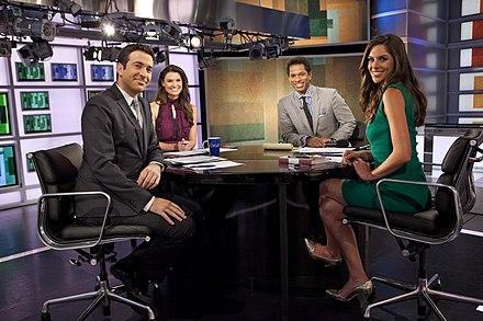 Hosts of The Cycle in 2013: Ari Melber, Krystal Ball, Toure and Abby Huntsman The Cycle (TV program), Ari Melber, Krystal Ball, Toure, Abby Huntsman-2013.jpg