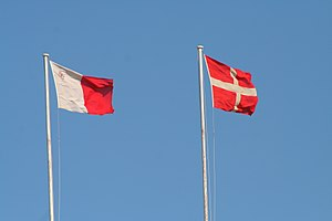 Flag and coat of arms of the Sovereign Military Order of Malta - Flags of Malta and the SMOM at Fort St. Angelo