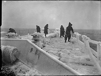 Arctic convoys of World War II - Members of the crew clearing the frozen focsle of HMS Inglefield.