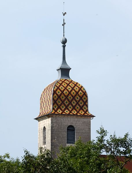 The nice churchtowerroof covered with coloured tiles at Chantrans Jura