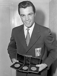 Toni Sailer with 3 gold olympic medals at Cortina 1956.jpg