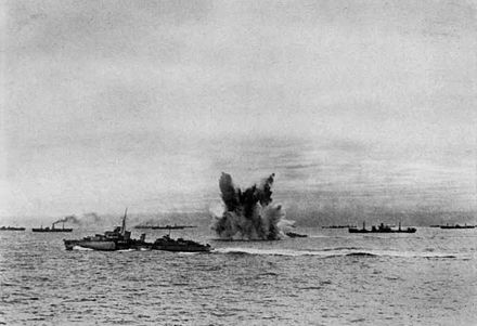 Convoy PQ 18 under attack by KG 30. Torpedo explosion in convoy c1942.jpg