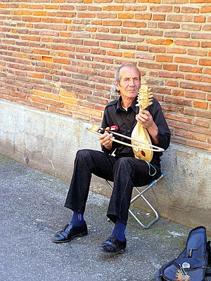 Gadulka - A street musician in Toulouse, France, playing a gadulka.