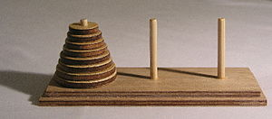A model set of the Towers of Hanoi (with 8 disks)